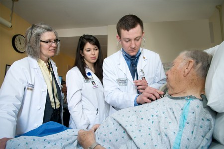 Dr. Fraser and students examine patient